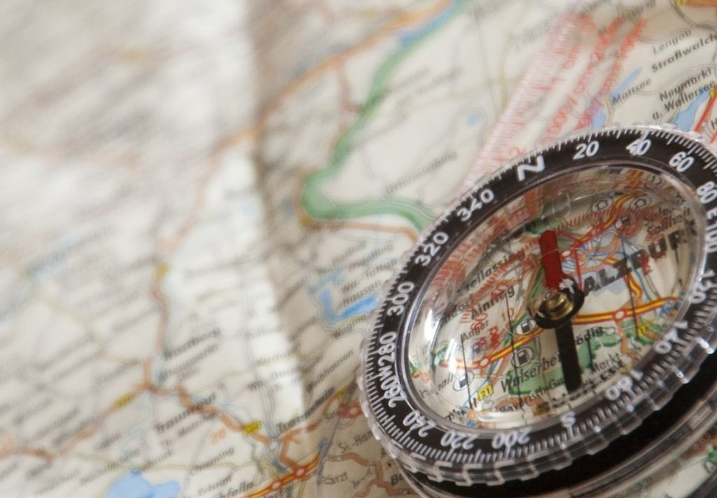 A compass laid on an Ordinance Survey Map