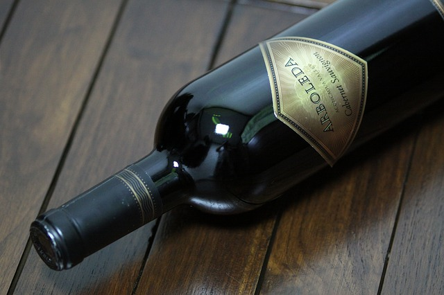 Wine bottle lying on a wooden table
